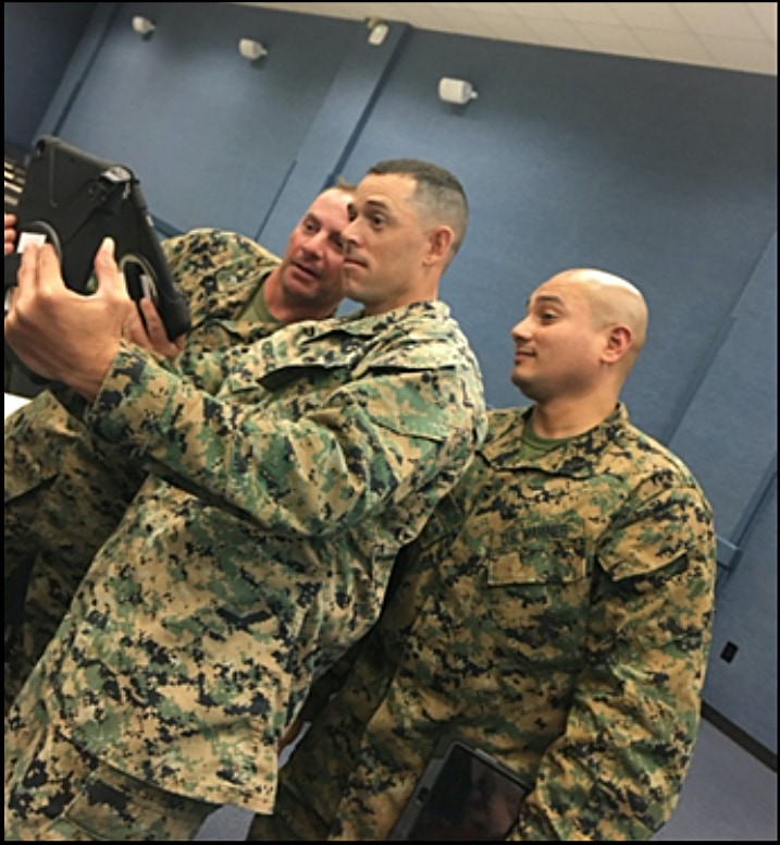Marines looking at tablet
